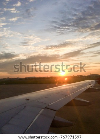 Morning sunrise with Wing of an airplane. #767971597