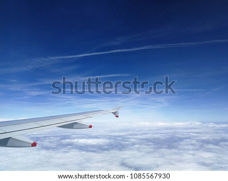 Morning sunrise with wing of an airplane above the clouds. picture for add text message #1085567930