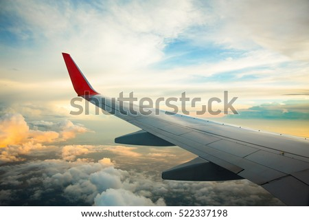Morning sunrise with Wing of an airplane. Photo applied to tourism operators. picture for add text message or frame website. Traveling concept  #522337198