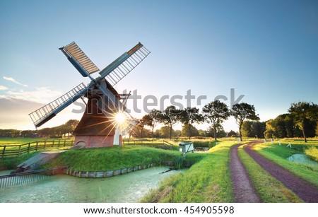 morning sunshine behind Dutch windmill, Holland Stock photo ©