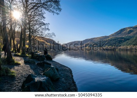 Morning sunshine in the Loch Lubnaig, Scotland, UK. Being one of the wettest place on earth it is very rare to see such a clear sky. #1045094335