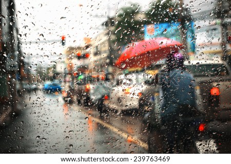 Morning traffic ,view through the window on rainy day