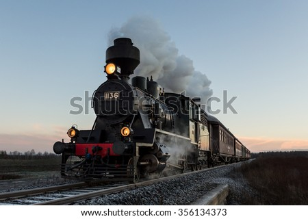 Morning train - Shutterstock ID 356134373
