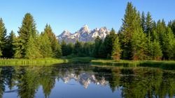 morning view of grand teton and pond at schwabachers landing
