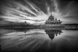Morning view of Putra Mosque and mirror like reflection, The Putra mosque also known as Masjid Putra in Malay language, its the principal mosque of Putrajaya, Malaysia. In Black and White