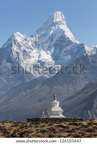Morning view of the Ama Dablam (6814 m) and buddhist stupa - Nepal, Himalayas
