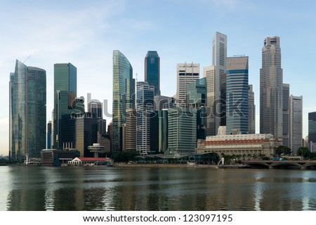 Morning view of the impressive skyline of Singapore's central business district as seen from the Esplanade over the Marina Bay.