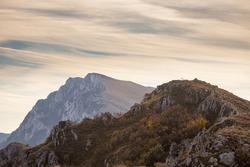 Morning view of Trem summit behind Sokolov kamen peak on Suva planina (Dry mountain), Serbia, during golden hour at autumn