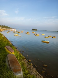 morning view of upside down rowboats at the bank of lake in boat club upper lake (bada talab), empty boat club during lockdown days, bhopal
