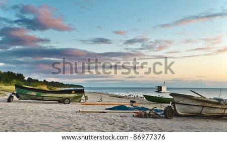 Morning view on the beach with facilities of collective fishing company, Gulf of Riga, Baltic Sea, Latvia
