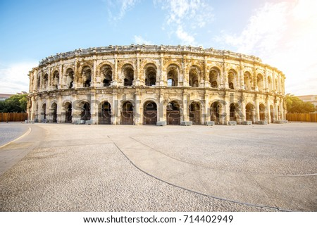 Morning view on the roman amphitheatre in the centre of Nimes city in France Stock fotó ©