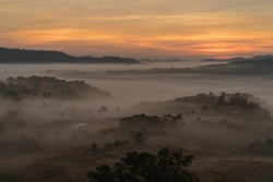 Morning view point with mountain mist. The landscape photo, beautiful sea fog in morning time at Khao Kho, Thailand.