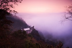 Morning view to the czech castle Krasov morning colors with fog under river, beautiful atmosphere of the morning
