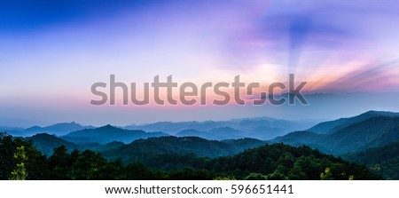 Morning view with sun-ray in national park with foggy environment. #596651441