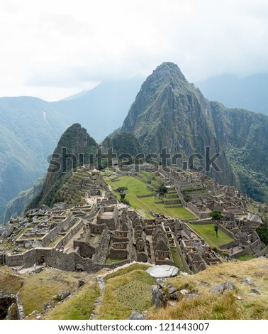 Morning views of Machu Picchu as mist clears from the mountainside