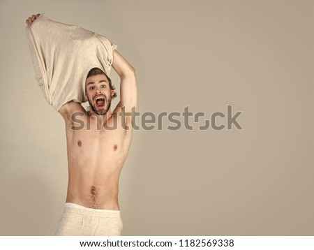 Morning wake up, everyday life. Barber and hairdresser, male fashion. Sleepy man undress on grey background. Insomnia, energy, single with uncombed hair. Man with disheveled hair in underwear.