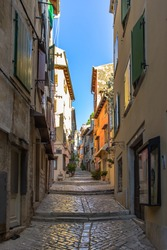 Morning walk in empty Croatian city of Rovinj.Picturesque narrow cobblestone streets,colorful facades,small shops,beautiful European cityscape.Summer holiday background.Real estate concept