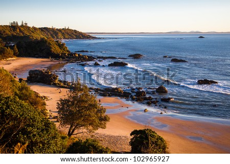 Morning walkers on the beach of Port Macquarie, New South Wales, Australia