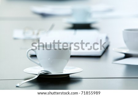 Morning workplace: cup of coffee and business objects on the table