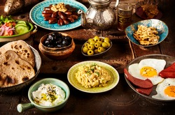 Moroccan Algerian breakfast table. Vintage background with different plates with delicious traditional middle eastern food