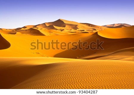 Moroccan desert landscape with blue sky. Dunes background. #93404287