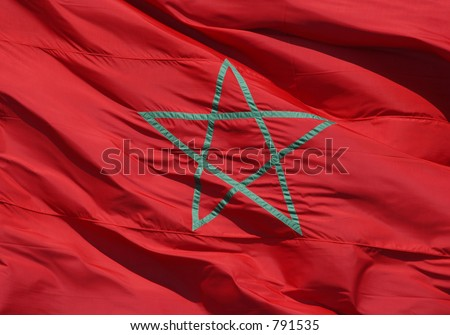 Moroccan national flag with the green star on the red background
