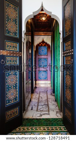 Moroccan painted doors and marble hallway.  Location: Interior in Marrakech, Morocco