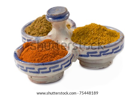 Moroccan spice container with curry powders on white background