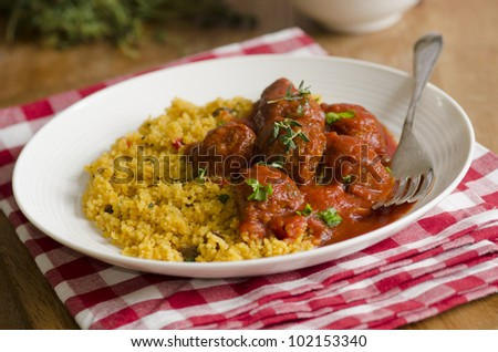Moroccan spiced meatballs in tomato sauce with couscous