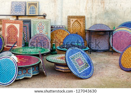 Moroccan tile mosaic table tops and fountains.  Location: Fez, Morocco
