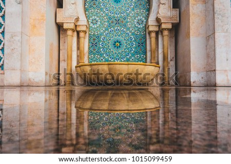Moroccan traditional water tap decorated with colorful shapes of mosaic - Casablanca, Morocco #1015099459