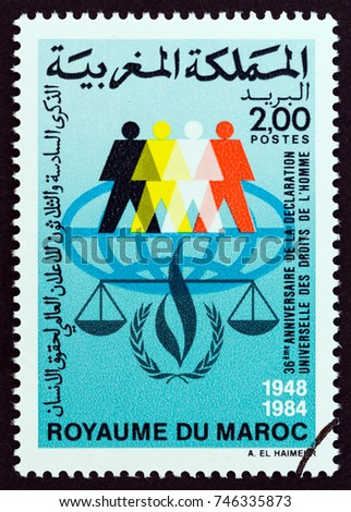 MOROCCO - CIRCA 1984: A stamp printed in Morocco issued for the 36th anniversary of UN Human Rights declaration shows human figures and scales, circa 1984.