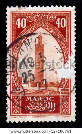 MOROCCO - CIRCA 1934: A stamp printed in Morocco shows Koutoubia, the biggest mosque of the Moroccan city of Marrakesh, red, circa 1934