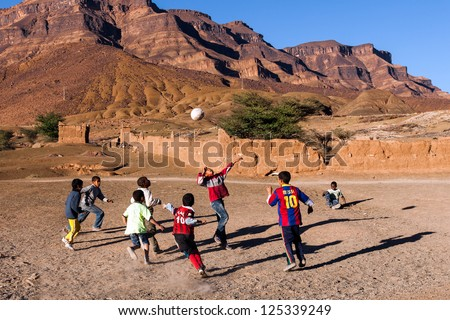 MOROCCO-DEC 27:Unidentified boys play soccer in a Draa Valley village, Morocco on Dec. 27, 2012. Soccer is the #1 sport among youth in Morocco today.