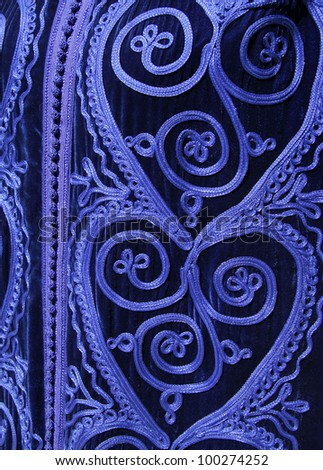 Morocco Detail of a woman's Berber blue intricately embroidered wool Caftan