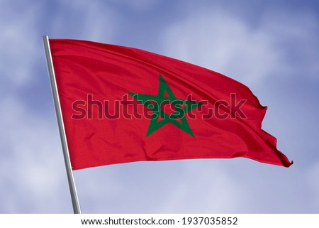 Morocco flag isolated on sky background. close up waving flag of Morocco. flag symbols of Morocco.
