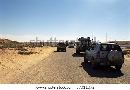 MOROCCO - JANUARY 3: Budapest - Bamako Rally cross the border to Mauritania at January 3, 2006, Morocco. The border is full of mines, so it is dangerous to cross.