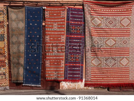Morocco Marrakesh Colorful Berber carpets for sale hanging in the Jemaa El Fna Square
