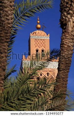 Morocco Marrakesh Koutoubia Mosque and Minaret framed by palm trees.