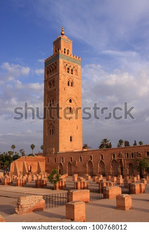 Morocco Marrakesh Koutoubia Mosque and Minaret in the late afternoon sunlight with dramatic sky