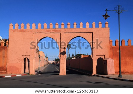 Morocco Marrakesh medieval city wall and double arched city gates