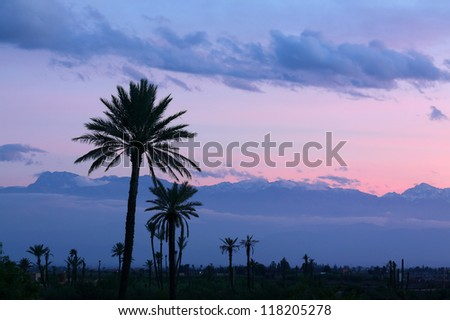 Morocco, Marrakesh, Panorama at dusk of the Atlas Mountains with light snow cover on the peaks.
