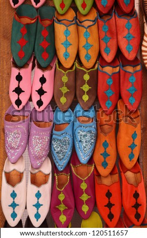 Morocco, Marrakesh, Typical colorful 'babuchas' - hand crafted leather slippers on display in the Medina souk