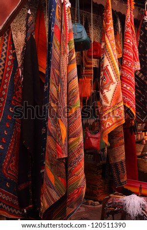Morocco, Marrakesh, Typical colourful woollen rugs and handy-craft articles on display in the historical Medina souk.