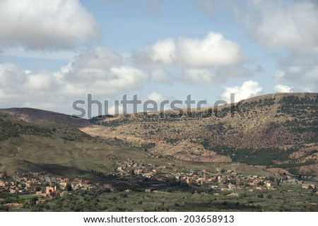 MOROCCO, MAY 13, 2014. Small buildings in a valley in the Atlas mountains of Morocco, on May 13th, 2014.
