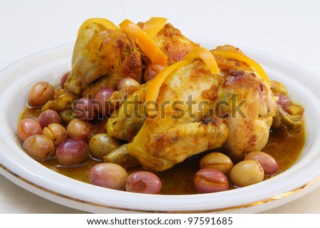 Morocco - Moroccan cuisine. Traditional tajine of roasted chicken with saffron, orange zest and olives