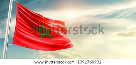Morocco national flag waving in beautiful sunlight.
