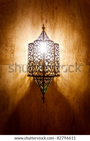 Morocco:  Ornate metal lamp in the wall of a mosque, Morocco.