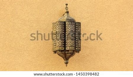 Morocco Ornate metal lamp in the wall of a mosque, Qatar. Morocco style lamp or lantern. Morocco Morocco Tourism,  culture, travel. #1450398482