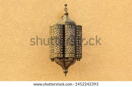 Morocco Ornate metal lamp in the wall of a mosque, Qatar. Morocco style lamp or lantern. Morocco Morocco Tourism,  culture, travel.